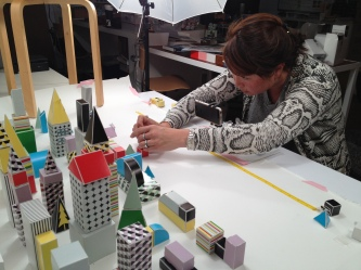 Grace arranges Paper Punk pieces for her stop-motion Kickstarter promo.